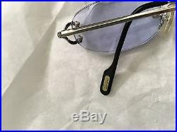 Vintage Cartier rimless pale blue glasses